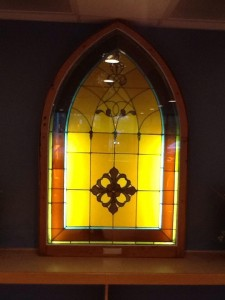 This stained glass window is from Westwood Baptist Church, built in 1895 (the predecessor to Faith Fellowship).